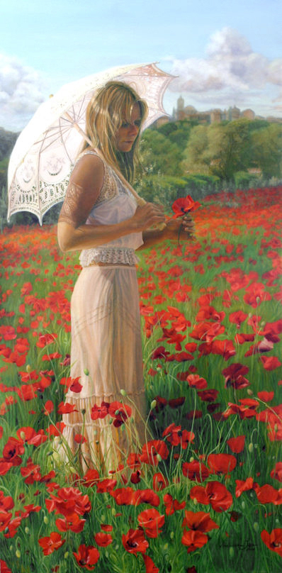 Girl with parasol in red poppy field in France